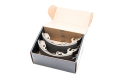 New car`s break shoes kit in the box on the white background Royalty Free Stock Images
