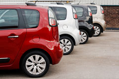 New car sales color choice. Row of new cars for retail sale in a motor dealer yard showing same model in different color choices Royalty Free Stock Photography