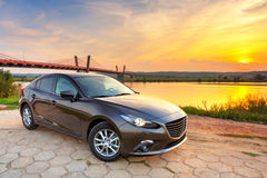 New car at sunset Royalty Free Stock Photos