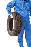New car tire and mechanic in studio Stock Photo