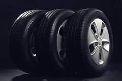 New car tires with rims. On black background Stock Photo