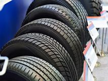 New car tires in store Royalty Free Stock Photos