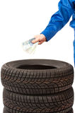 New car tires in studio and hand with cash Stock Photography