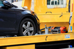 New car transported on tow track Royalty Free Stock Photography