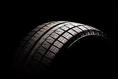 New car tyre on a black background Royalty Free Stock Photography