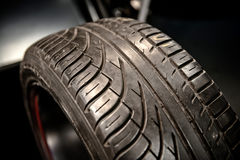 New car tyre closeup photo Stock Photos