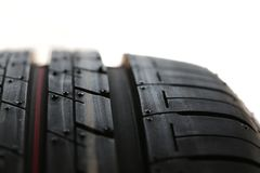 New car tyre (tire). A close-up shot of a new car tyre (tire) showing its groves and patterns with white background Royalty Free Stock Photo