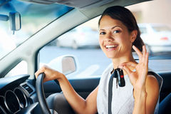 New car woman. Happy woman new car owner smiling and showing keys in driver seat Stock Images