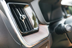 New car inside detail view. New Car wooden part with aluminum parts Royalty Free Stock Photos