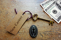 New Career. Key and keyhole with money -- changing jobs or getting a raise concept Royalty Free Stock Photography
