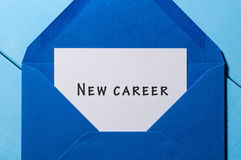 New Career written on the white paper at blue envelope. Opportunity, facilities concept. New Career written on the white paper at blue envelope. New opportunity Stock Images