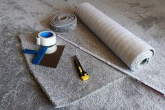 A new carpet is laid.  stock photos