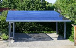 New carport with semi transparent photovoltaik moduls royalty free stock images