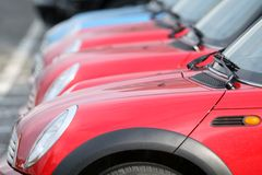 New cars. Many red cars for sale Royalty Free Stock Images