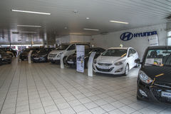 New cars in a car-dealership Royalty Free Stock Images