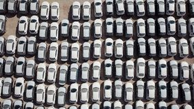 New cars covered in protective white sheets. Parked in a holding platform - Aerial image Royalty Free Stock Photos