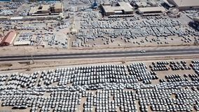 New cars covered in protective white sheets. Parked in a holding platform - Aerial image Royalty Free Stock Photography