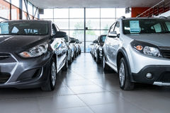 New cars at dealer showroom Royalty Free Stock Images