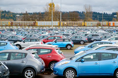 New cars in holding lot. Kent, WA, USA November 28, 2016: New cars from various manufacturers waiting for delivery to dealers after being unloaded from train in Stock Image