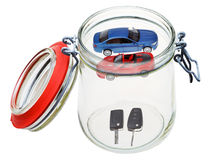 New cars and keys in glass jar Stock Photo
