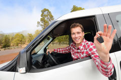 New cars - man driving car showing car keys happy Royalty Free Stock Image