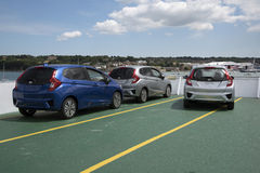 New cars on open deck of a ship bound for the Isle of Wight UK Stock Photo