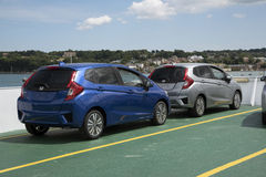 New cars on open deck of a ship bound for the Isle of Wight UK Stock Images