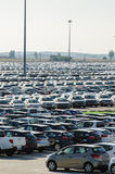 New cars parked at distribution center Stock Images
