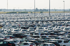 New cars parked at distribution center Stock Photos