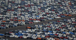 New Cars Parked in a Lot. New cars, just off a cargo ship, sit in rows to be shipped around the country Stock Photography