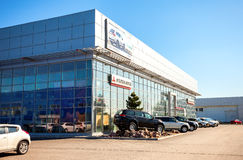 New cars parked up near the office building of official dealer M Royalty Free Stock Photos