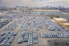 New cars in rows stored at port Rashid in Dubai, UAE stock image