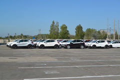 New cars stand on the territory of automobile plant Stock Images
