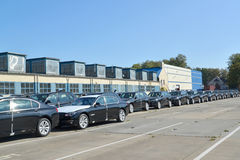 New cars stand on the territory of automobile plant. Russia Stock Images