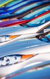 New Cars Stock in Row. Modern Compact Cars Dealership Parking Lot Closeup Stock Images