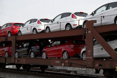New cars. Train delivering brand new cars Royalty Free Stock Image