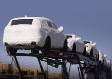 New cars under wraps being delivered Royalty Free Stock Image