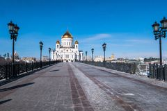 The new Cathedral of Christ the Saviour as viewed from the bridge over the Moscow River. Moscow. Russia. The Cathedral of Christ the Saviour is a Russian stock images