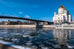The new Cathedral of Christ the Saviour and the Patriarchy pedestrian bridge over the Moscow River in Moscow. Russia. The Cathedral of Christ the Saviour is a royalty free stock images