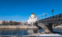 The new Cathedral of Christ the Saviour and the Patriarchy pedestrian bridge over the Moscow River in Moscow. Russia. The Cathedral of Christ the Saviour is a stock photos