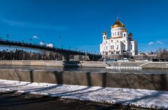 The new Cathedral of Christ the Saviour and the Patriarchy pedestrian bridge over the Moscow River in Moscow. Russia. The Cathedral of Christ the Saviour is a stock image