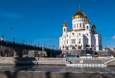 The new Cathedral of Christ the Saviour and the Patriarchy pedestrian bridge over the Moscow River in Moscow. Russia. The Cathedral of Christ the Saviour is a stock photography