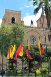 New Cathedral with national and local flags in Cuenca, Ecuador Stock Photo