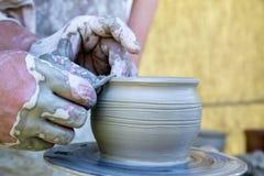 New ceramic pot. Potters hands starting to design new ceramic pot Stock Photos