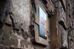 A new certificate sign on wall of very old building. A new brewery certificate placed on pub building, making a great contrast with its old walls Royalty Free Stock Photo