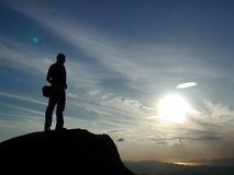 New Challenge. A person take his new challenge at the top of a mountain Royalty Free Stock Images