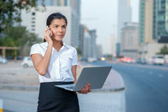 New challenges. Confident businesswoman standing on a street in Royalty Free Stock Photos