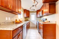 New cherry wood American kitchen interior. Royalty Free Stock Photography