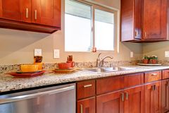 New cherry wood American kitchen interior. Stock Images