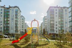 New children`s playground near a apartments building stock photography